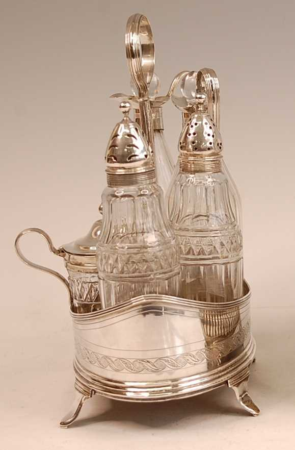 A George III silver five-bottle cruet, of oval form, with bright cut engraved decoration, comprising - Image 3 of 4