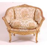 A 19th century giltwood and gesso tub chair, the swept frame with acanthus leaf moulding, silk
