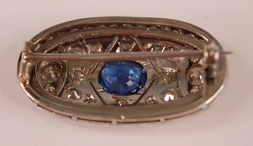 A white metal Art Deco style sapphire and diamond lozenge shaped panel brooch, featuring a centre - Image 2 of 3