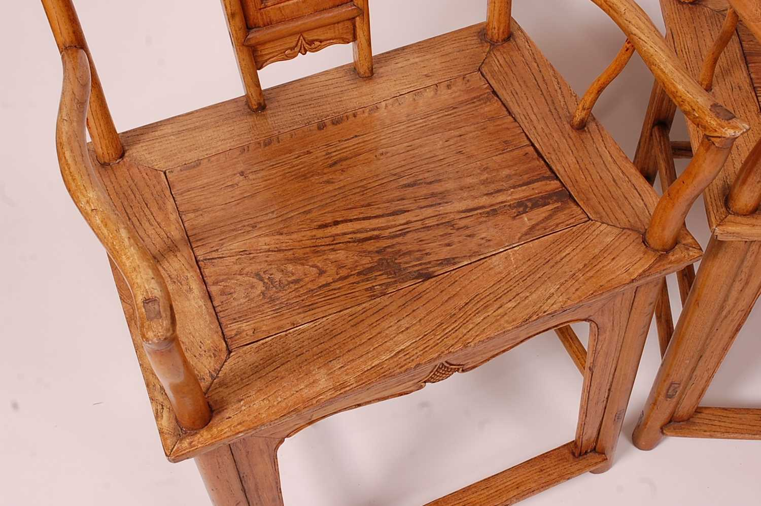 A pair of Chinese 'elm' elbow chairs, having carved splat yoke backs - Image 4 of 5