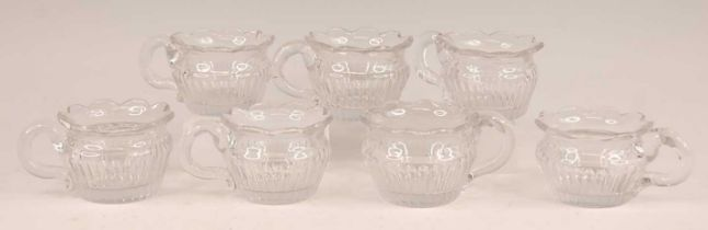 A set of seven William IV cut glass custard cups, each with fluted tapering bodies, dia. 7cm