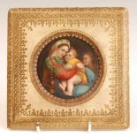 19th century continental school - Madonna and Child, miniature on porcelain, dia.9cm, housed in a
