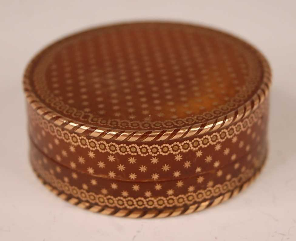 A George III tortoiseshell cylindrical dressing table box, with gold piqué stars and raised