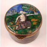 A gilt and enamel decorated circular pill box, having gilt metal hinged lid, the black ground