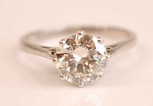 A platinum diamond solitaire ring, comprising a round brilliant cut diamond in an eight claw Rex