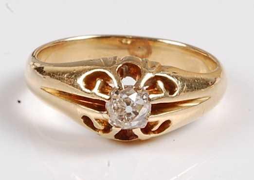 A yellow metal diamond single stone ring, featuring an Old European cut diamond in a scalloped