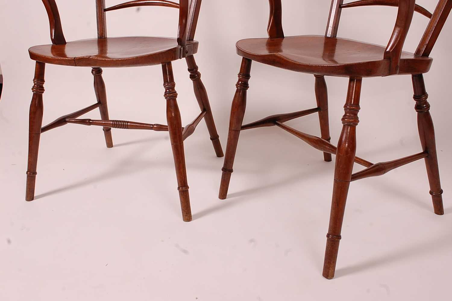 A near-pair of 19th century elm seat and fruitwood Mendlesham chairs, each having ball and pierced - Image 6 of 6