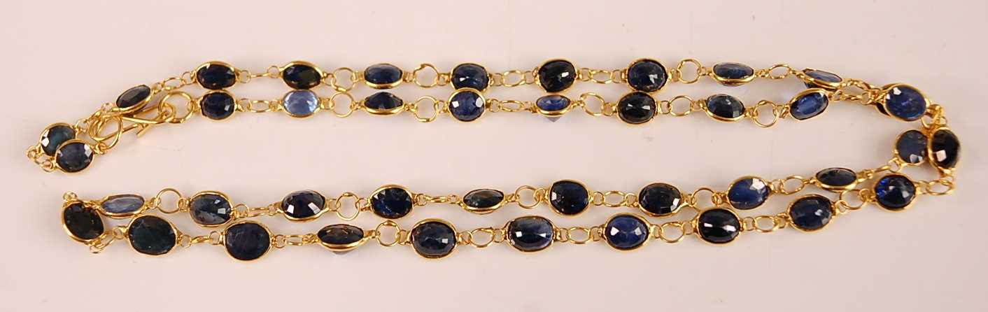 A contemporary yellow metal sapphire set necklace, arranged as 42 oval cut sapphires, each - Image 2 of 2