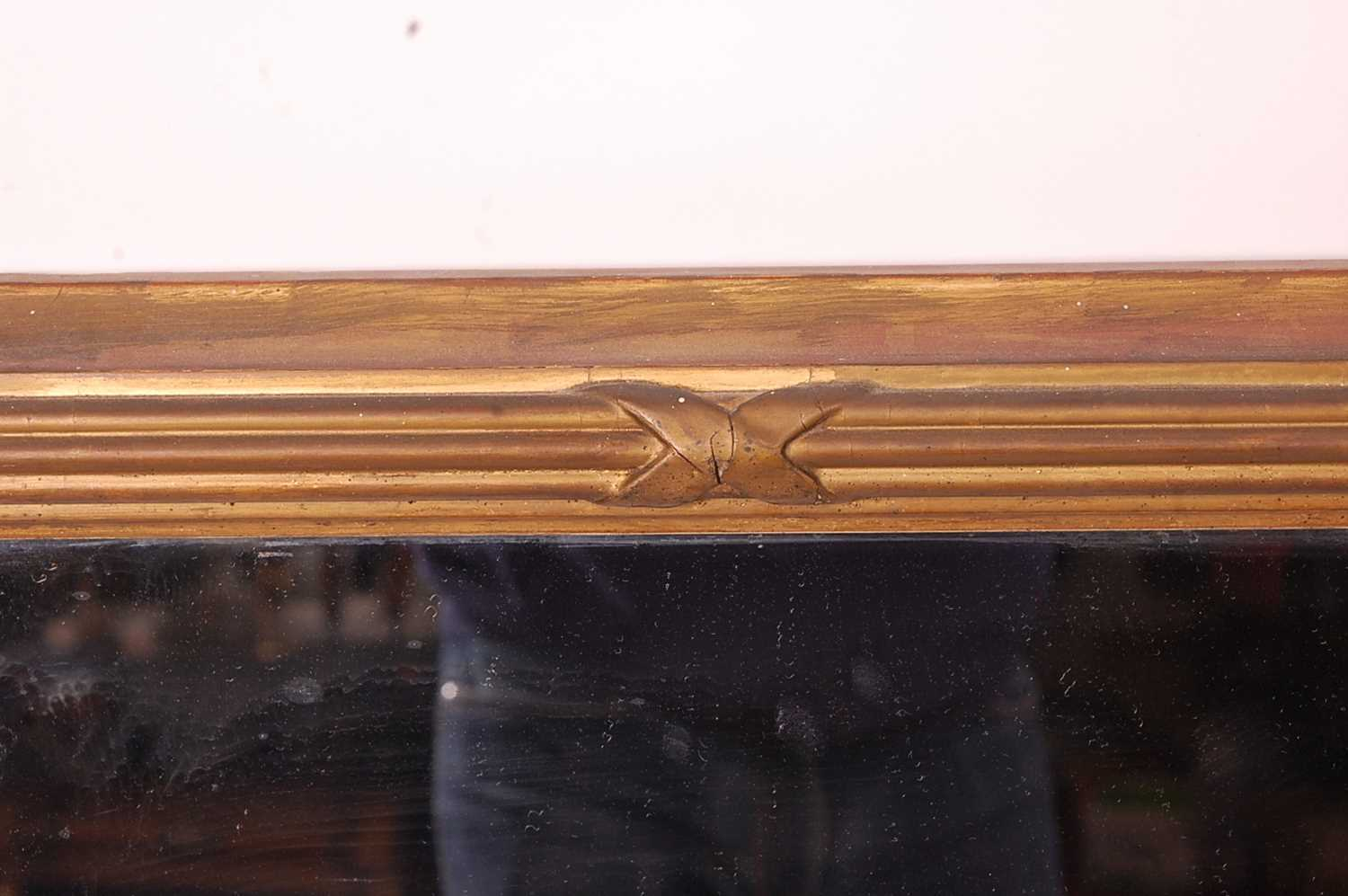A 19th century giltwood and composition wall mirror, the rectangular plate within a proud reeded - Image 4 of 5