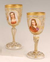 A pair of 19th century Bohemian overlaid glass pedestal goblets, each enamel decorated with bust