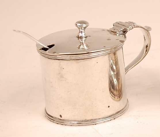 An Edwardian silver mustard pot with blue glass liner, silver weight 5.2oz, maker George Perkins,