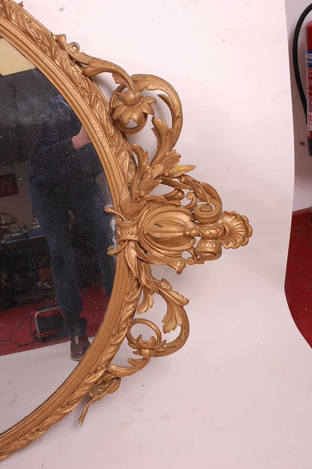 A Victorian giltwood and gesso wall mirror, of good size, the oval plate within a leaf moulded - Image 5 of 6