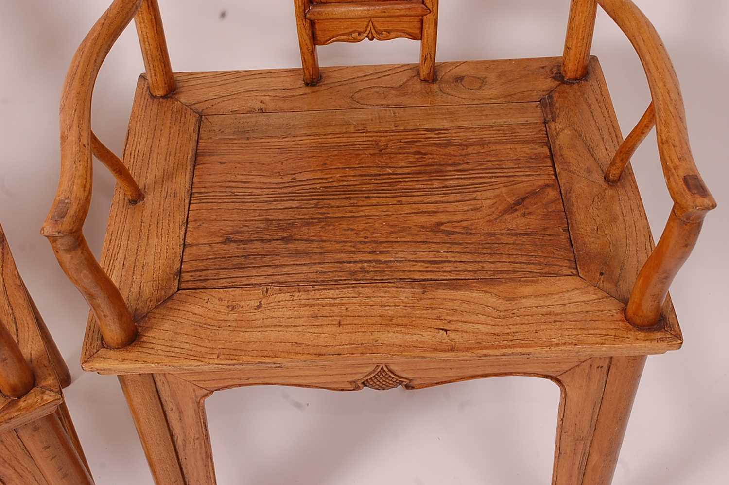 A pair of Chinese 'elm' elbow chairs, having carved splat yoke backs - Image 5 of 5