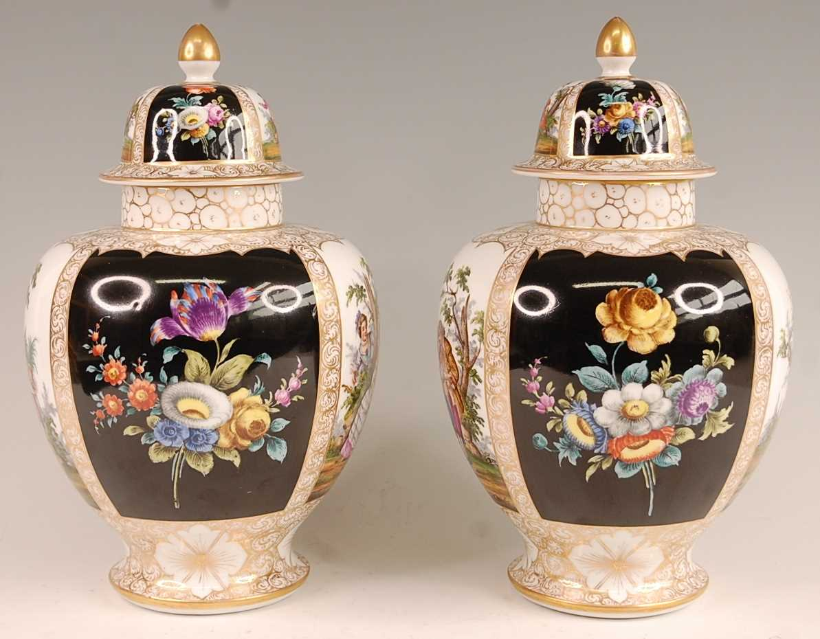 A pair of circa 1900 Dresden porcelain vases and covers, each panel decorated with alternating - Image 4 of 7