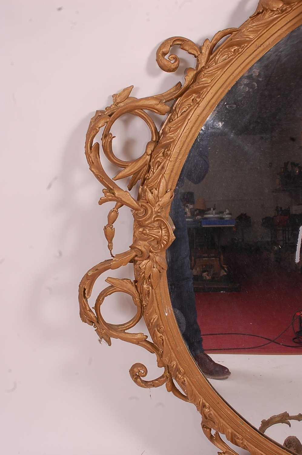 A Victorian giltwood and gesso wall mirror, of good size, the oval plate within a leaf moulded - Image 4 of 6