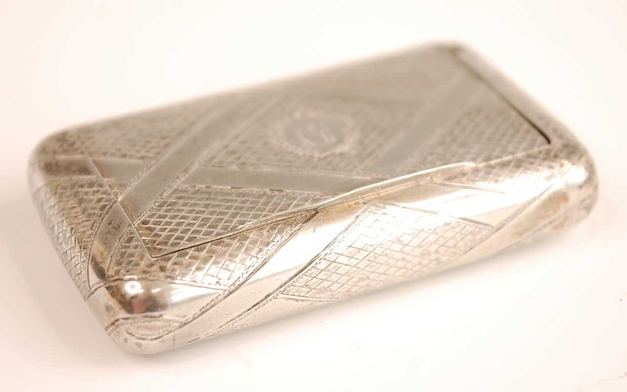 A George III silver pocket snuff box, having engine turned and strapwork decoration, gilt-washed