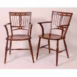 A near-pair of 19th century elm seat and fruitwood Mendlesham chairs, each having ball and pierced