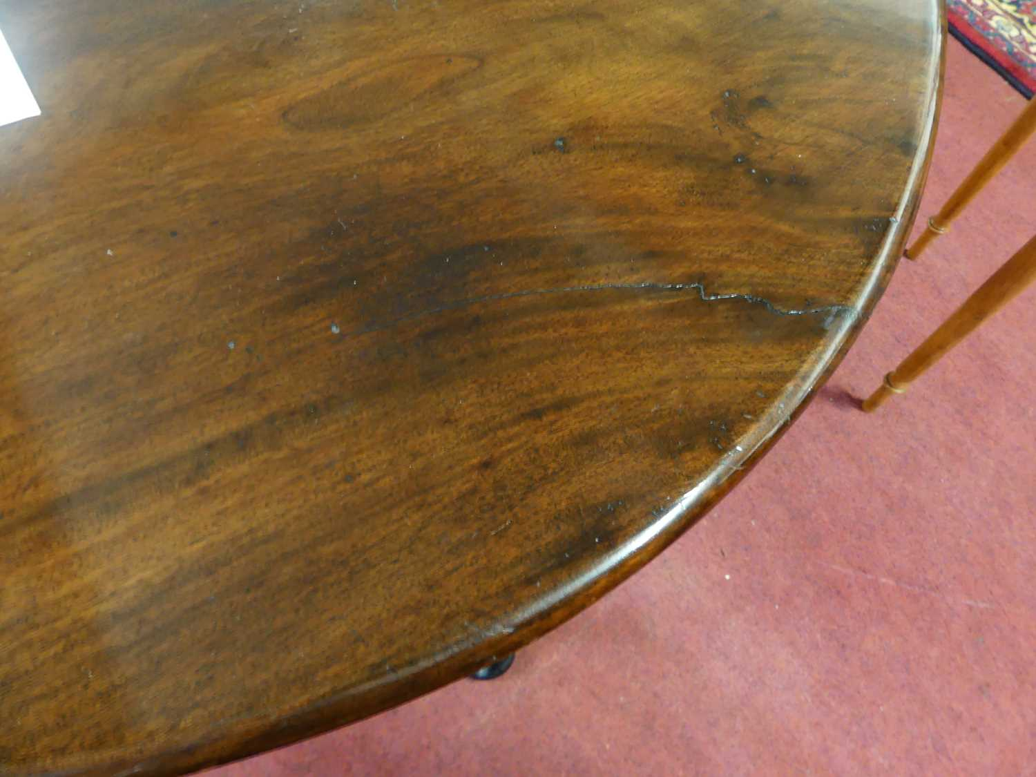 A George III mahogany padfoot dining table, the oval leaves on gatelegs, w.110cm, d.141cm, h. - Image 5 of 5