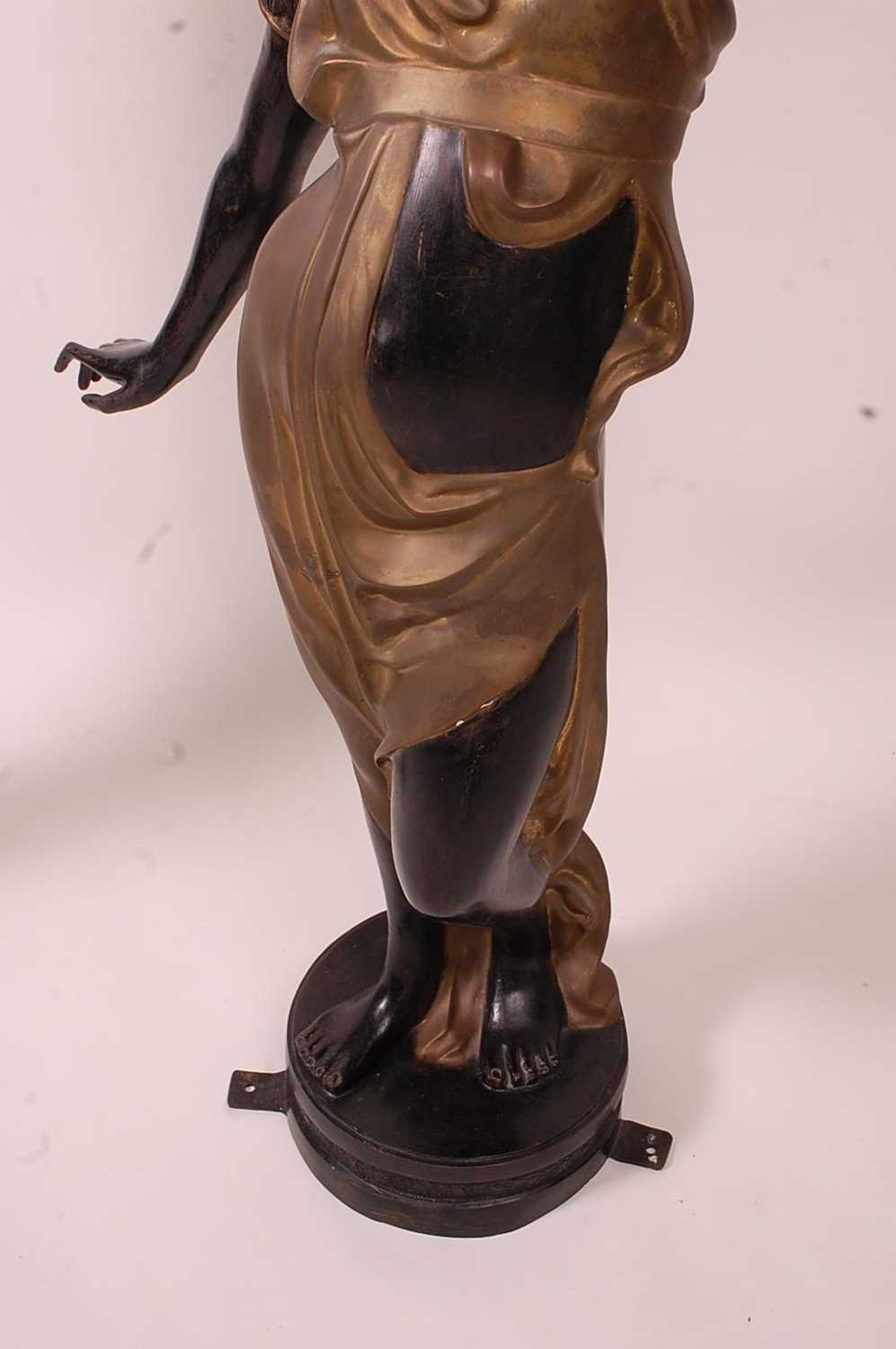 A pair of bronzed metal figurines of maidens, each holding aloft a flaming torch, in black and gilt, - Image 4 of 9