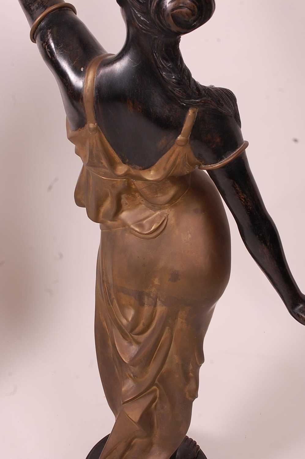 A pair of bronzed metal figurines of maidens, each holding aloft a flaming torch, in black and gilt, - Image 8 of 9