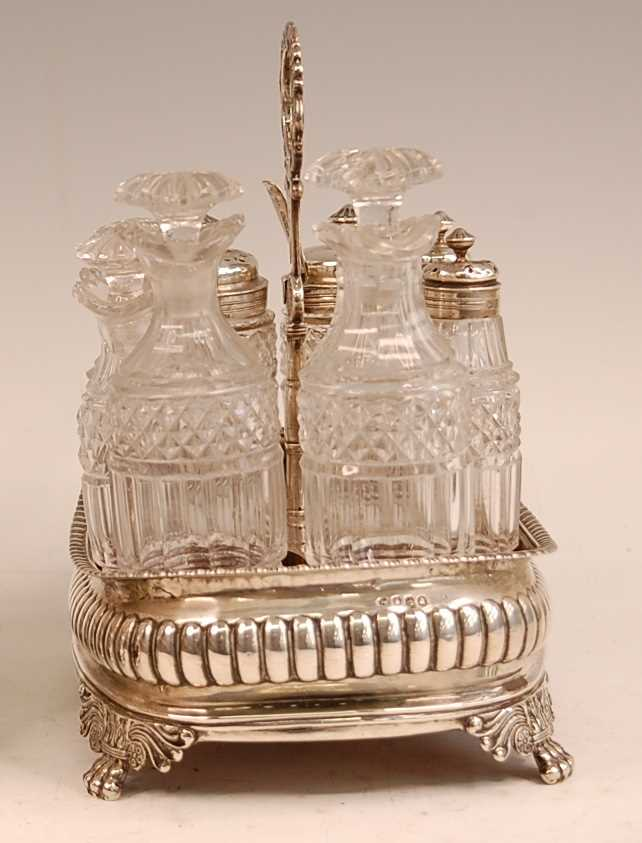 A George III silver eight-bottle cruet, of reeded oval bombe form, with gadrooned rim and lion paw - Image 3 of 4
