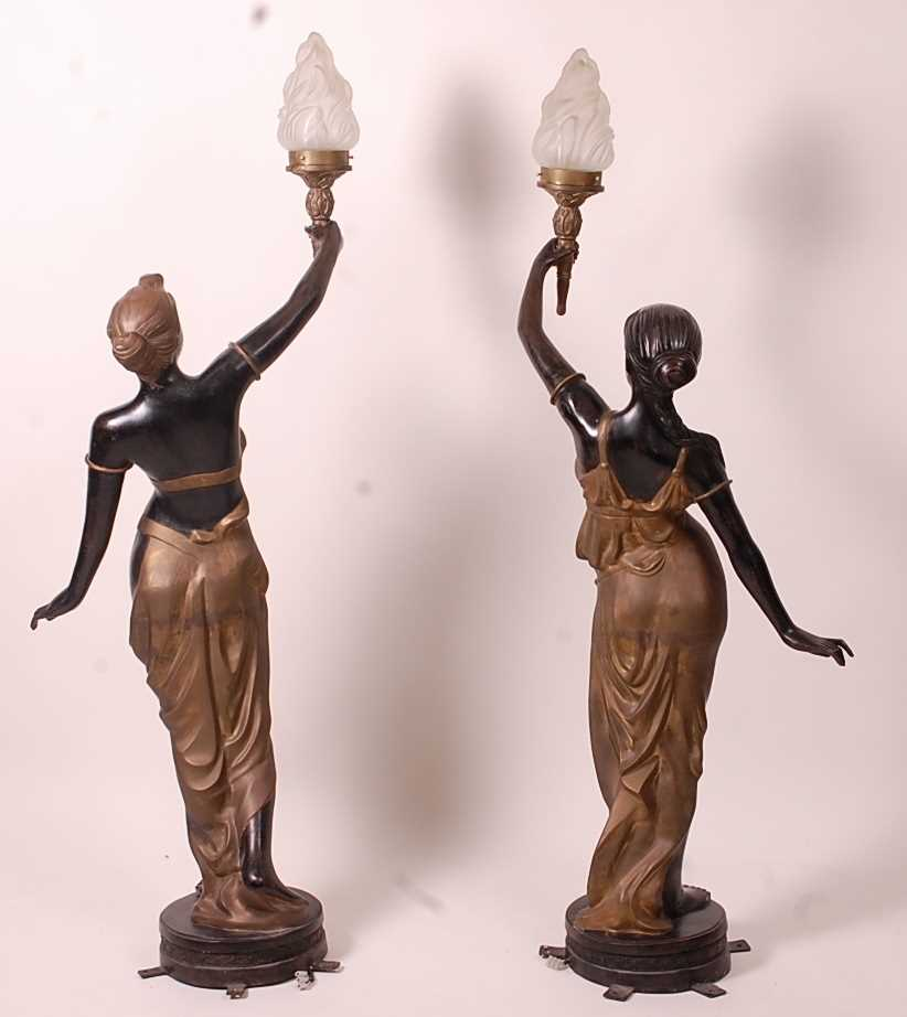 A pair of bronzed metal figurines of maidens, each holding aloft a flaming torch, in black and gilt, - Image 7 of 9