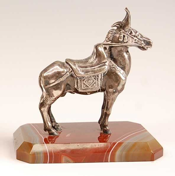 An early 20th century continental white metal model of a donkey, in standing pose and full livery, - Image 2 of 4
