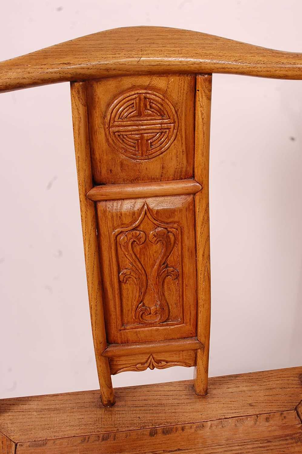 A pair of Chinese 'elm' elbow chairs, having carved splat yoke backs - Image 3 of 5