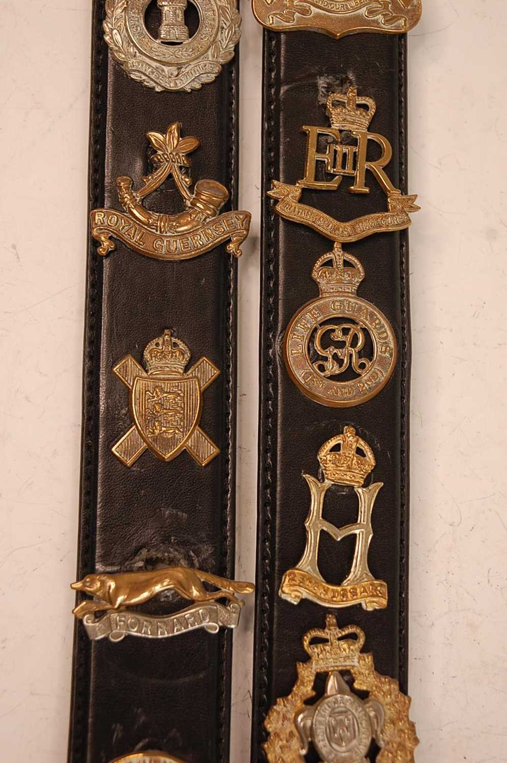 A collection of cap badges and insignia to include The Border Regiment, Cornwall Regiment, East - Image 4 of 9