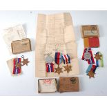 A collection of WW II medals to include 1939-1945 Star and Africa Star with Service slip in O.H.M.S.