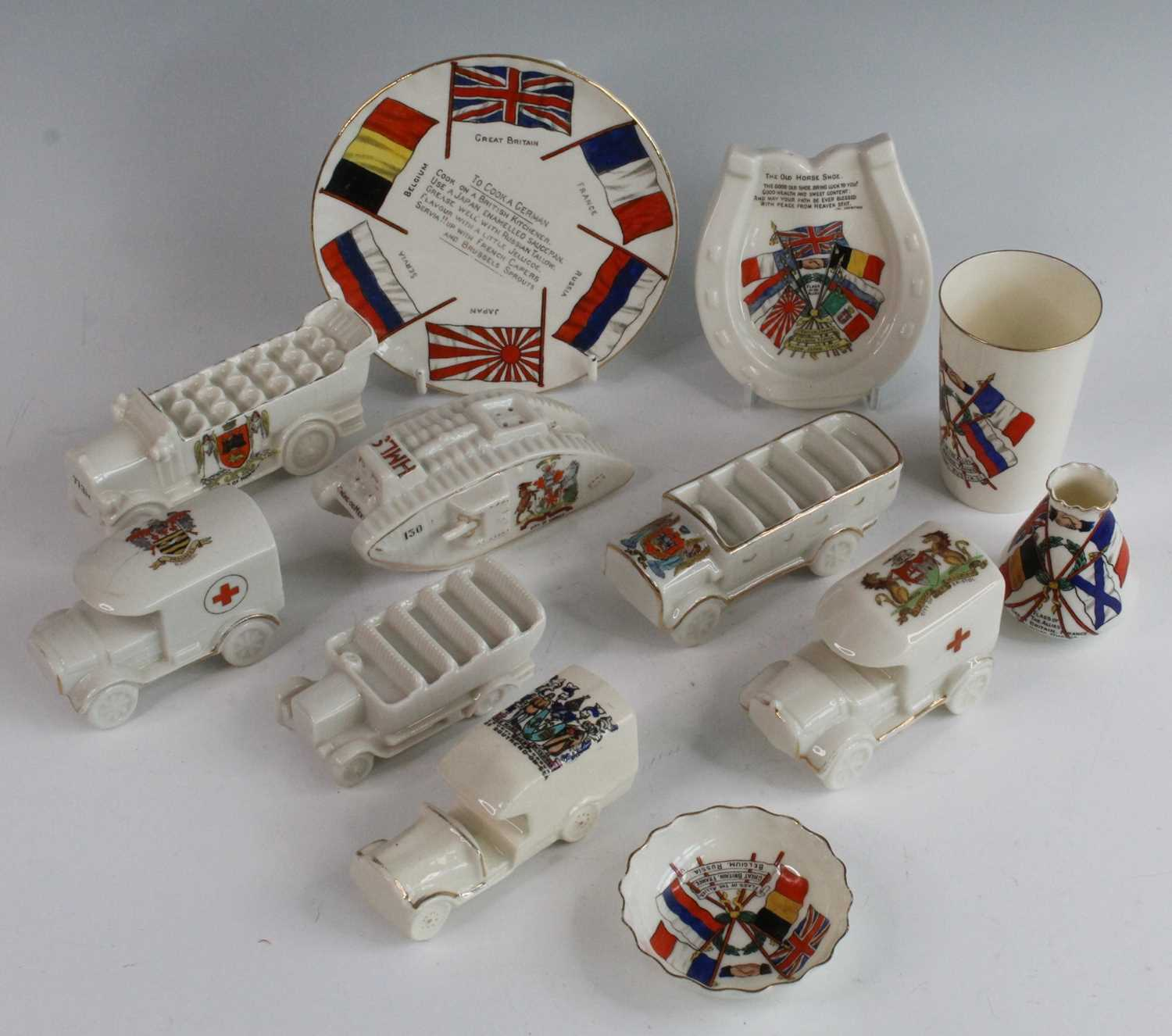 A collection of WW I / Military related crested cabinet china to include a W.H. Goss beaker