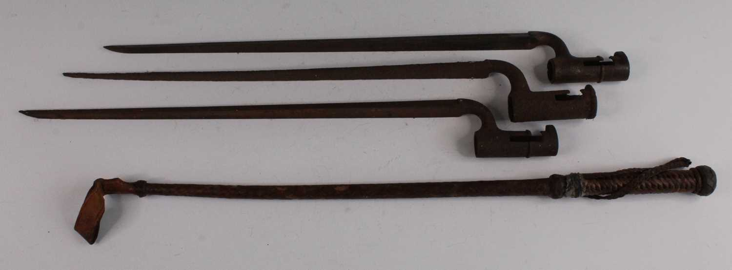 A 19th century socket bayonet, together with two other similar examples and a plaited leather clad