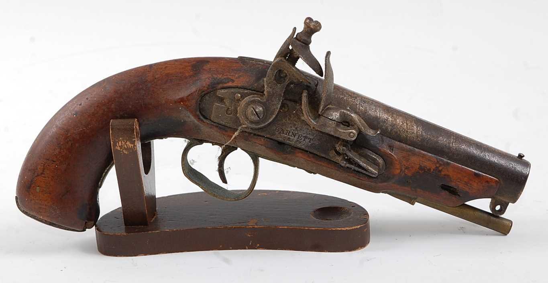 An early 19th century flintlock Revenue Customs Service Issue pistol, the 11cm circular barrel