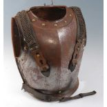 A 19th century French Cavalry cuirass, the breast plate with medial ridge, brass rivets and rolled