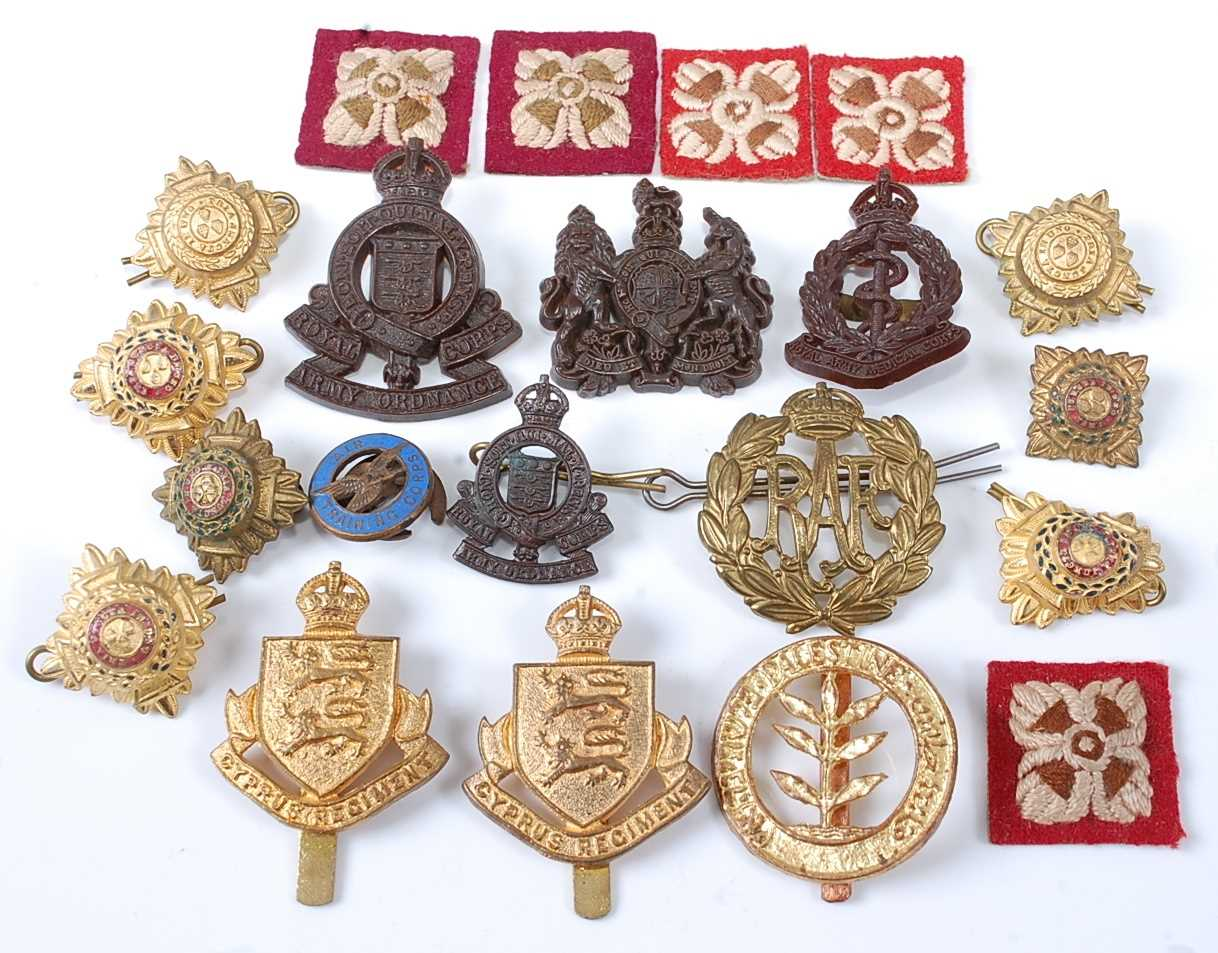 A collection of cap badges and insignia to include Palestine Regiment, Cyprus Regiment x2, each