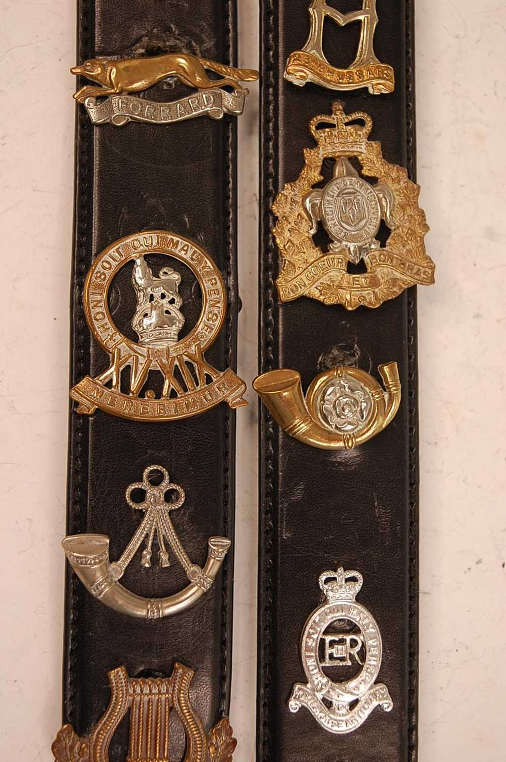 A collection of cap badges and insignia to include The Border Regiment, Cornwall Regiment, East - Image 5 of 9