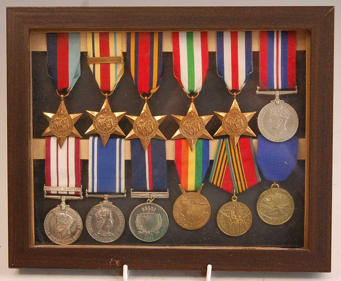 A group of twelve medals to include 1939-1945 Star, Africa Star with North Africa 1942-43 clasp,