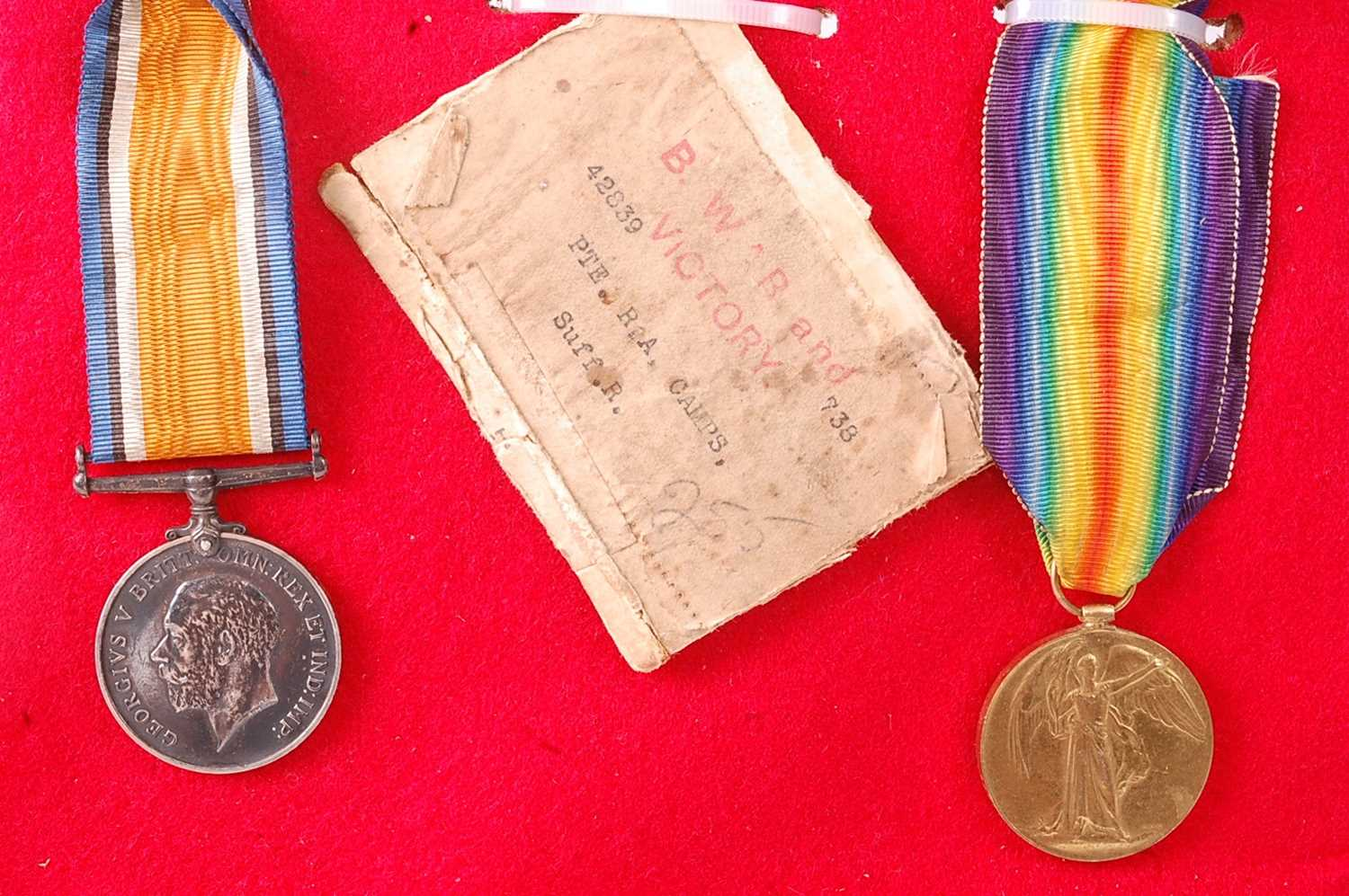 A WW I British War and Victory pair, naming 42839 PTE. R.A. CAMPS. SUFF. R., together with the