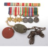 A miniature group of medals to include 1939-1945 Star, Africa Star, Italy Star, Defence, War and