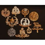 A collection of cap badges and buttons to include Suffolk Regiment, Norfolk Regiment, York and