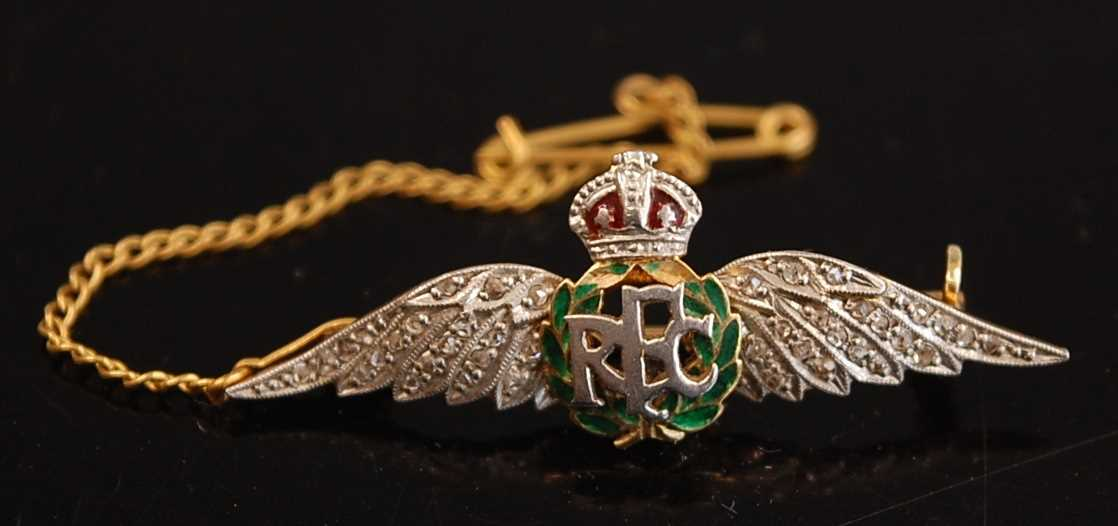 A yellow metal, enamelled and diamond set R.F.C. sweetheart brooch, with safety chain, 4cm, together