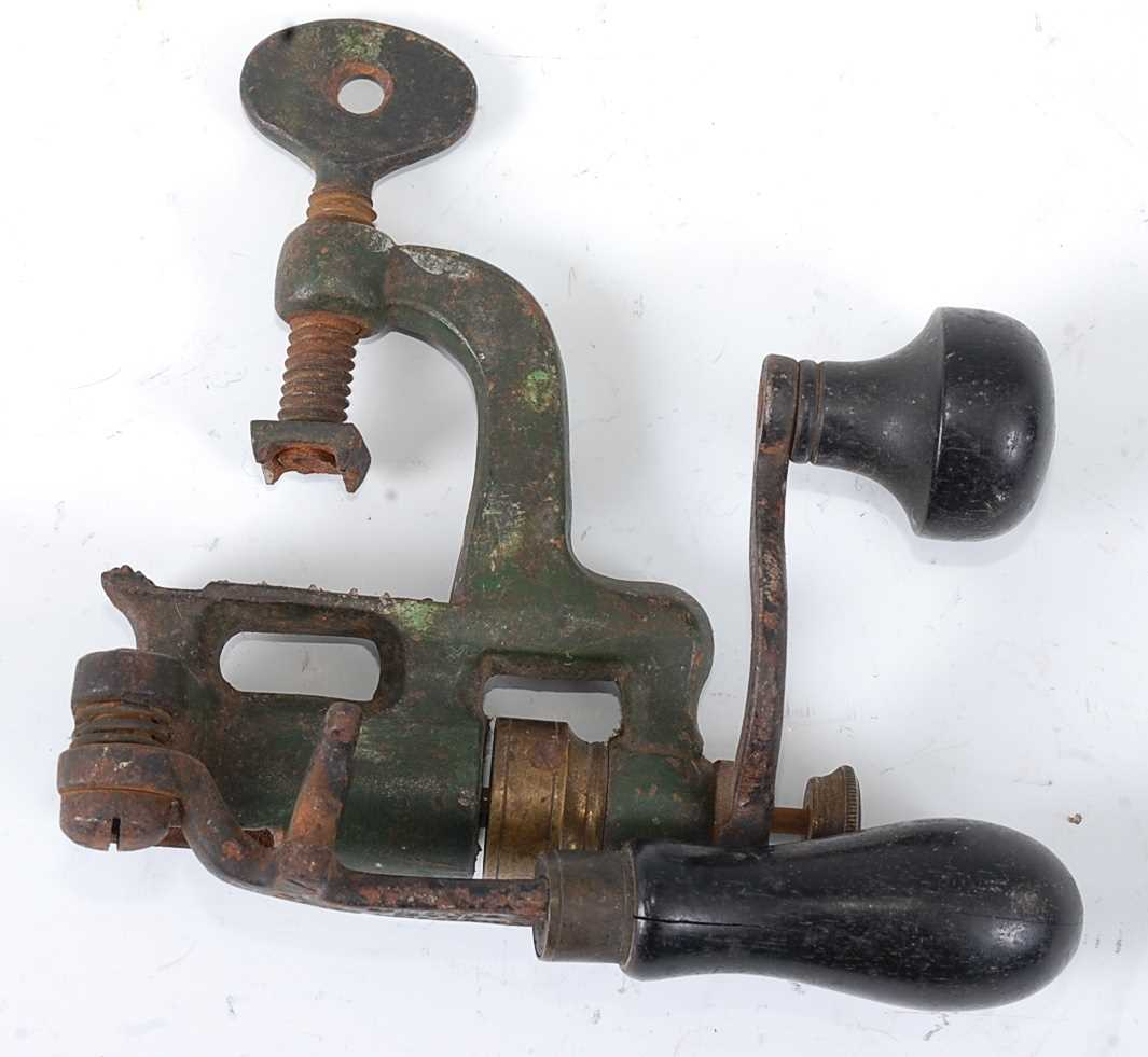 A 19th century cast iron and brass mounted cartridge loader, by James Dixon & Sons, 15cm.