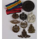 A collection of cap badges, shoulder titles and insignia to include Royal Engineers, RAF, Royal Army