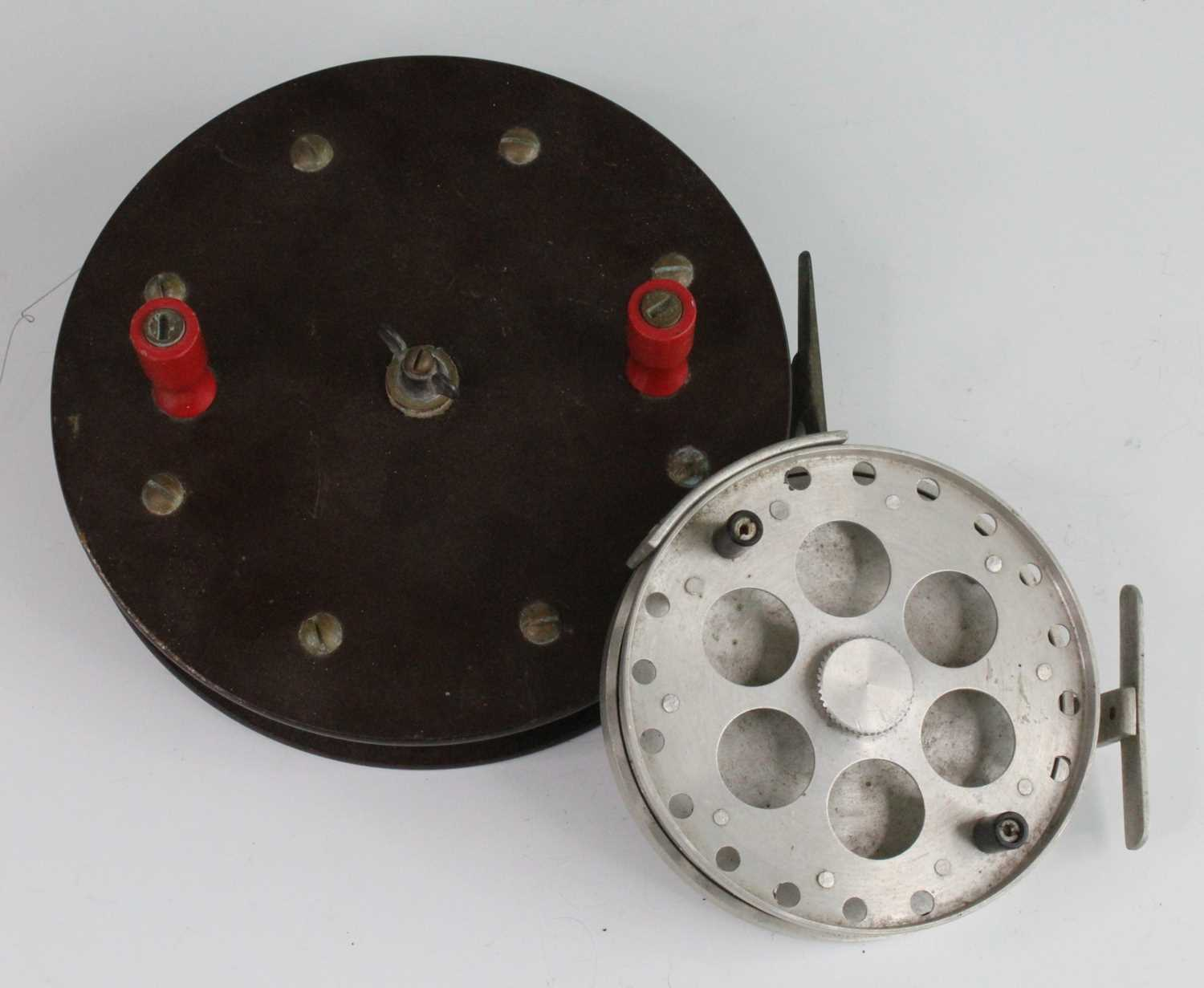 """A 1930's unmarked bakelite 8"""" centre pin sea reel, together with an unmarked alluminium 5"""" centre"""