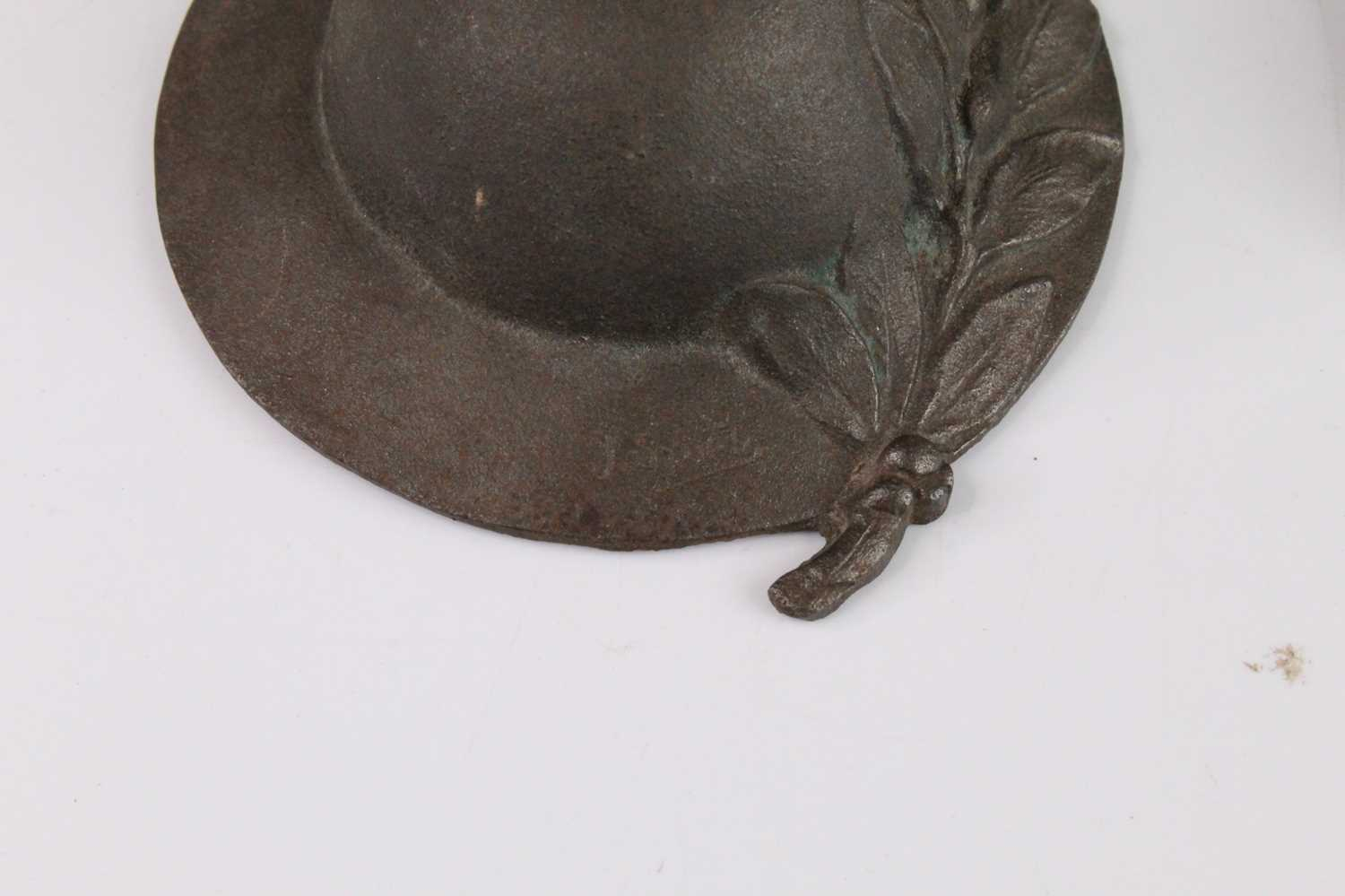 A miniature Brodie helmet embossed with laurel leaves, marked Ypres and signed J. Smit, dia.9cm, - Image 2 of 3