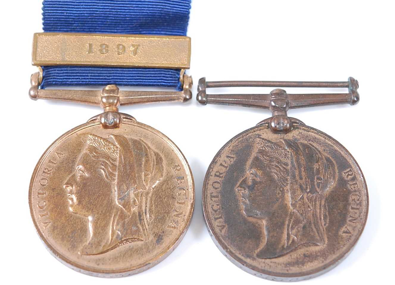 An 1887 Metropolitan Police medal with 1897 clasp, naming P.C. A. BEDFORD V. DIVN, together with one