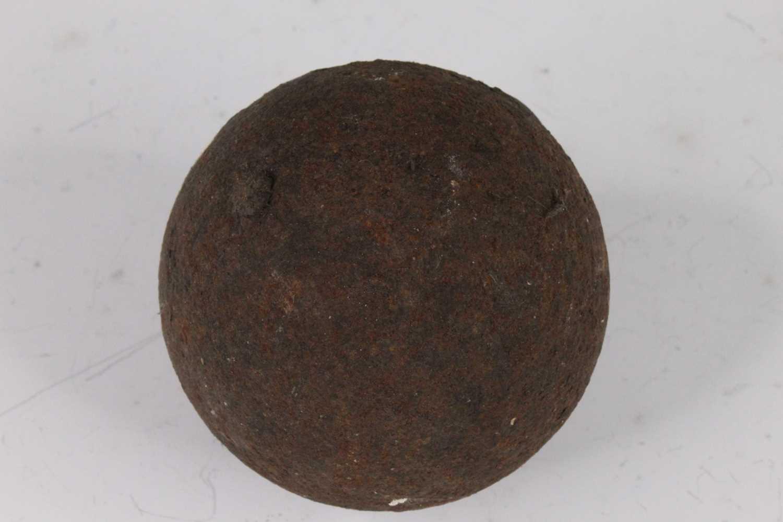 An 18th/19th century iron cannon ball, dia.9cm.