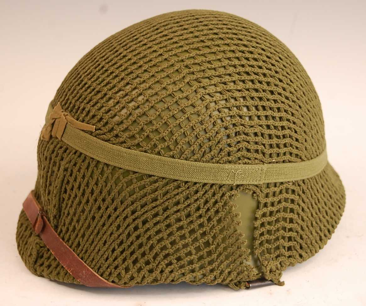 A Danish M1948 steel helmet, with leather/canvas liner and outer net.