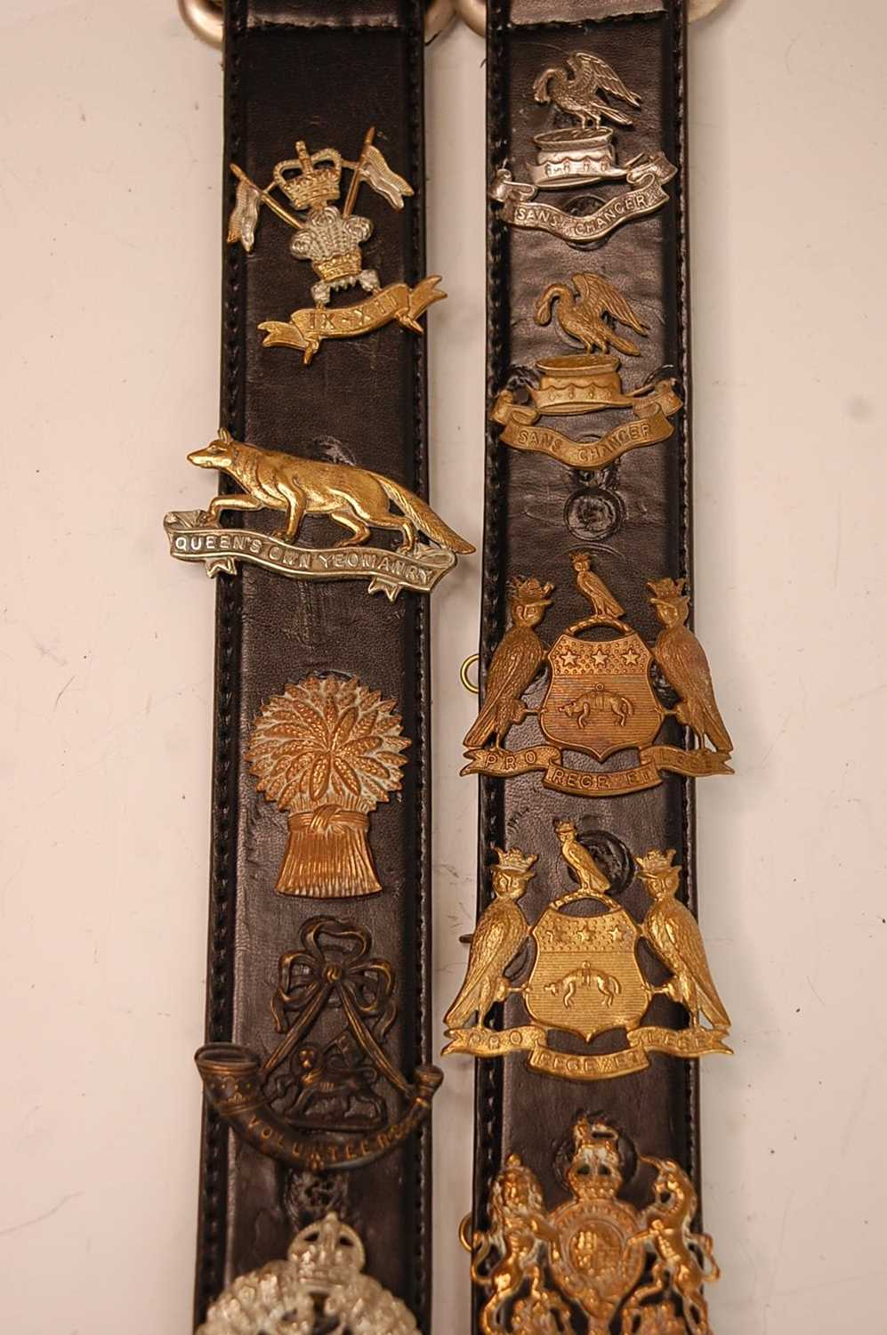 A collection of cap badges and insignia to include The Border Regiment, Cornwall Regiment, East - Image 2 of 9