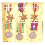 A collection of six WW II medals to include Italy Star, 1939-1945 Star, Africa Star, Defence x2